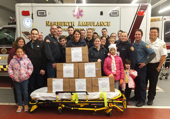 EMS volunteers donate Thanksgiving dinners to low-income families